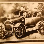 Split body photo of two men and child driving in car