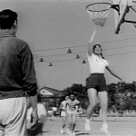 Girl making basketball shot in movie Woman Basketball Player, No. 5