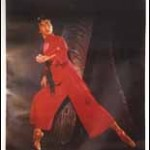 Woman dressed in red martial arts gear