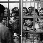 Group of women behind window adoring Tian Zhenhua