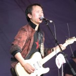 Cui Jian playing the guitar and singing