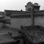 Gong Li as Songlian on a roof