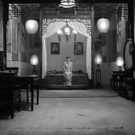 Gong Li as Songlian waiting in room