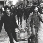 Young Couple carry home new tv, ca. 1980's