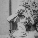 Carpenter putting on glasses in Laborer's Love (dir. Zhang Shichuan, 1922)