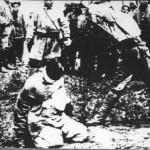 blindfolded man on knees