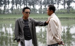 Fei Mo (left) and Yan Shouyi (right)
