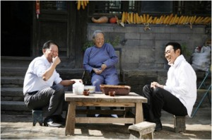 Fei Mo (left), grandma (middle), and Yan Shouyi (right) seated and laughing