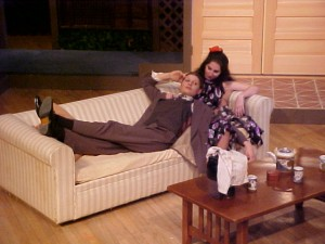 The husband (Chloe Demrovsky) rests against the bosom of the wife (Rebecca Jones) in a cross-dressing, all-female production of ?Flushed with Wine? at Simon?s Rock College of Bard, November 2002.