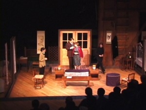 "Fig. 2: ""A Wasp,"" with men playing men and women playing women. From left, Rebecca Jones as Mrs. Ji, Loren Vandegrift as Mr. Ji, Christa Brelsford as Miss Yu, and Chloë Demrovsky as the servant."