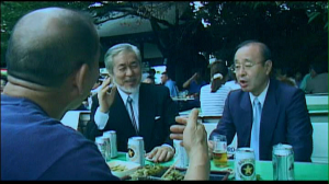 Fig. 7: Three men relax over a beer in Yasukuni on August 15, 2005.