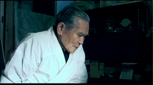 Fig. 8: Kariya Naoji often prefers not to answer the director's questions, and appears lost in thought.