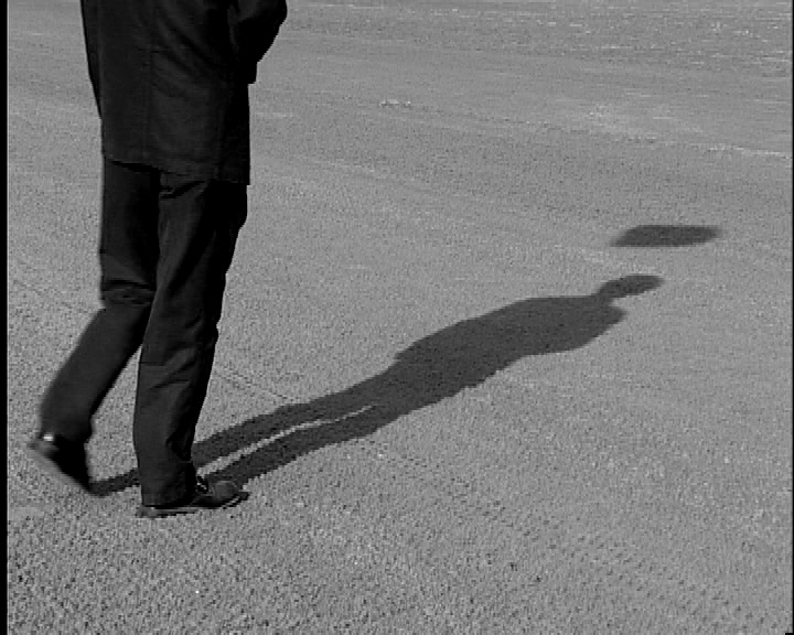 Fig. 3: Gao Xingjian's silhouette and his shadow, Marseille, 2003. (Photo courtesy of Alain Melka/Jean-Louis Darmyn and Triangle Méditerranée.)
