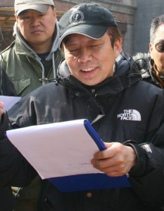 Huang Jianxin on the set of The Founding