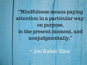 blue wall with quote by Jon Kabat-Zinn