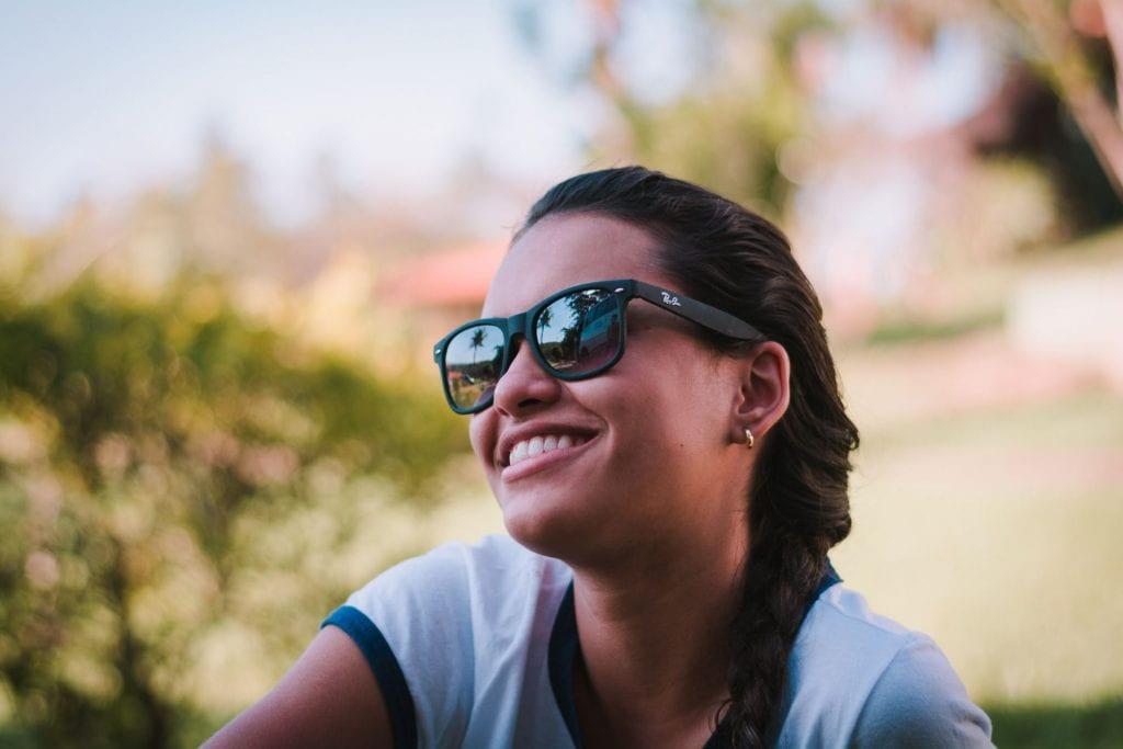Alex Gonzalez wearing sunglasses in a park