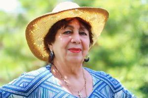 Alex's mom Sofia with a straw hat