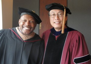 Archie Griffin and Ken Lee in academic regalia