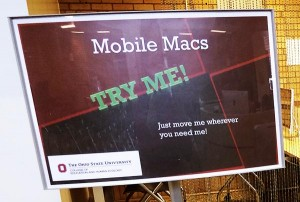 Sign inviting users to try the computers. Text reads Mobile Macs. Try Me! Just move me wherever you need me. Ohio state logo bottom left.