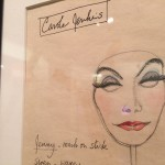 Sketch of a mask with female makeup. Long lashes, arched eyebrows, blue eye shadow, and red liipstick.