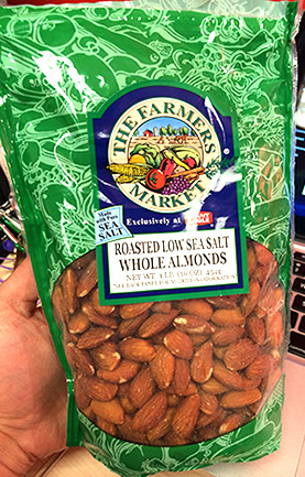 Green zip top bag of roasted low sea salt whole almonds