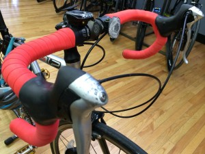 Picture of bike with bright red handlebar tape.