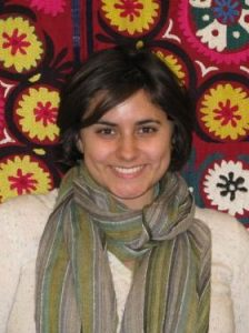 image of cassie patterson wearing a green scarf against a colorful background