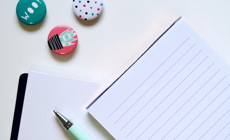 white notepad with three pins