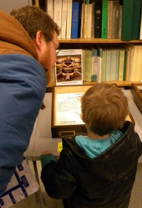 Father and son admire one of the Triplehorn Collection's insect displays.