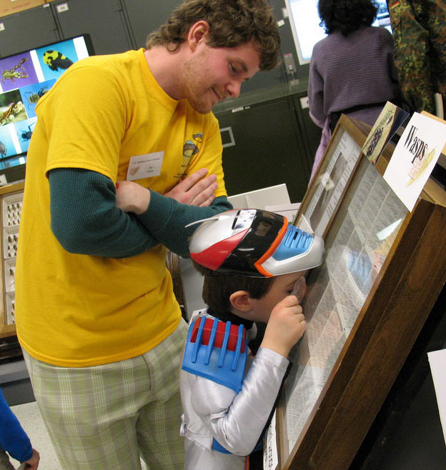 Joe Cora with young superhero during the 2008 Museum Open House.