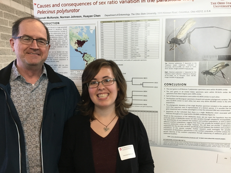 author and research advisor with poster