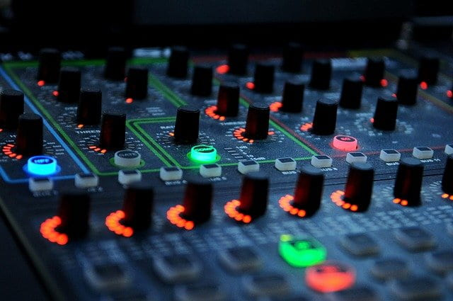 Close-up of mixing board with glowing displays