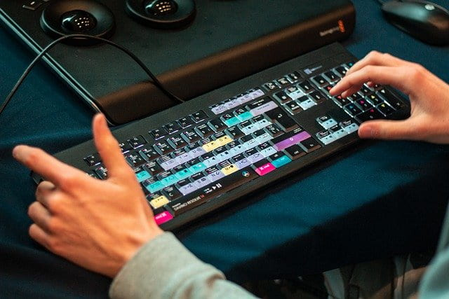 Hands on keyboard of non-linear editing