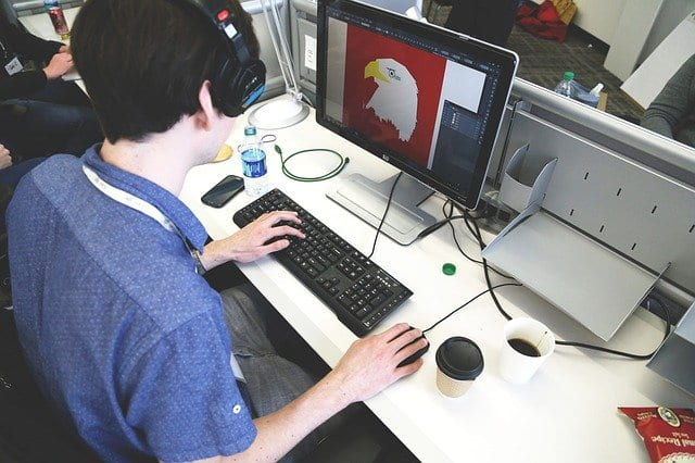 Student designer graphic of bald eagle on a computer