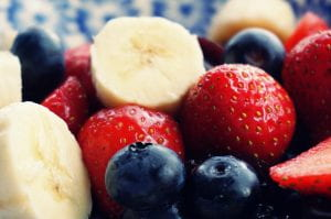 bowl of strawberries, blueberries and bananas