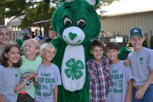 4-H members with clover (4-H Mascot) enjoying the Clermont County Fair
