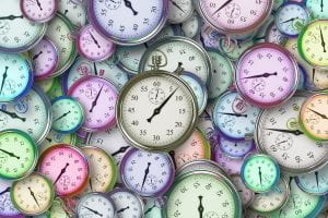 collage of pastel colored clocks