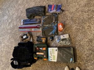 items displayed on the floor from the survival kit