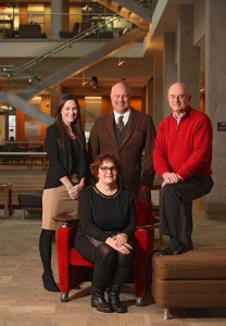 The Higher Education Center Leadership team: Standing (left to right) – Kristin Dahlquist, Program Manager; John Clapp, Director; Ken Hale, Associate Director. Seated – Connie Boehm, Associate Director.