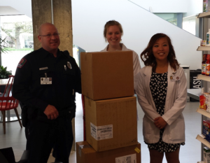 OSU Police Officer Dave Ferimer, and P3 Pharm.D. students Andrea Haugtvedt and Lena Wu with boxes of unneeded drugs for destruction at the conclusion of our latest event. Photo courtesy of Candance Haugtvedt.