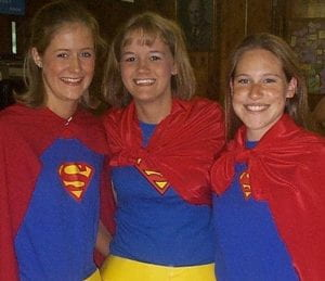 3 girls wearing Superman costumes