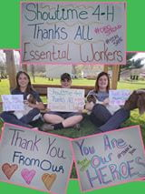 4-H'ers with signs to thank essential workers