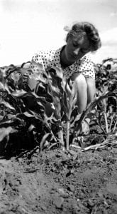 Girl with corn plant
