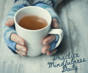 hands hold mug of tea