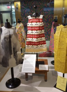 Exhibit case of paper dresses featured in the Thompson Gallery
