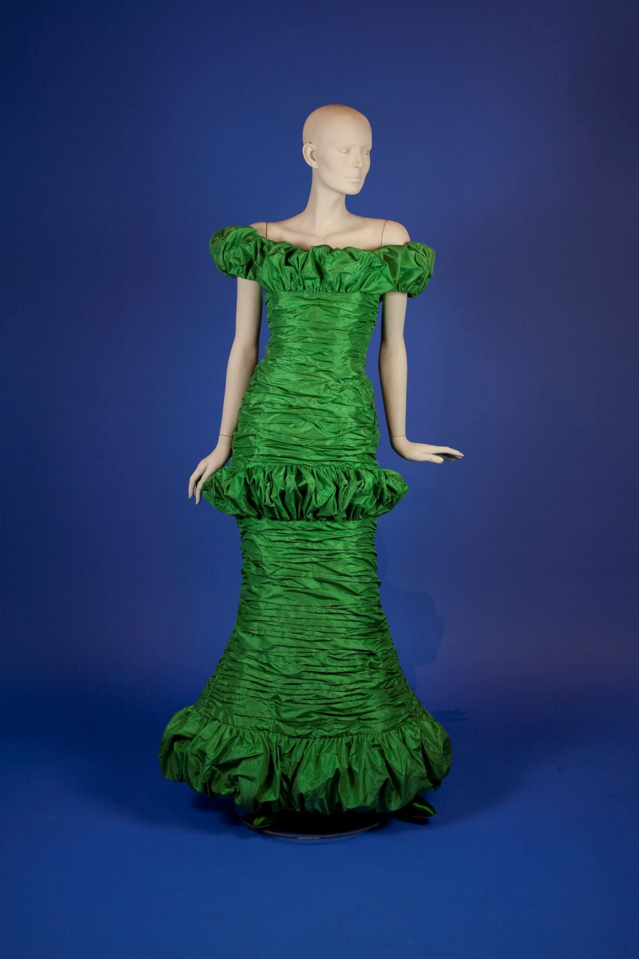 347980ef2 It is a long green silk taffeta sheath gown from 1988. It is a wonderful  representation of his designs at the time with the bold ...