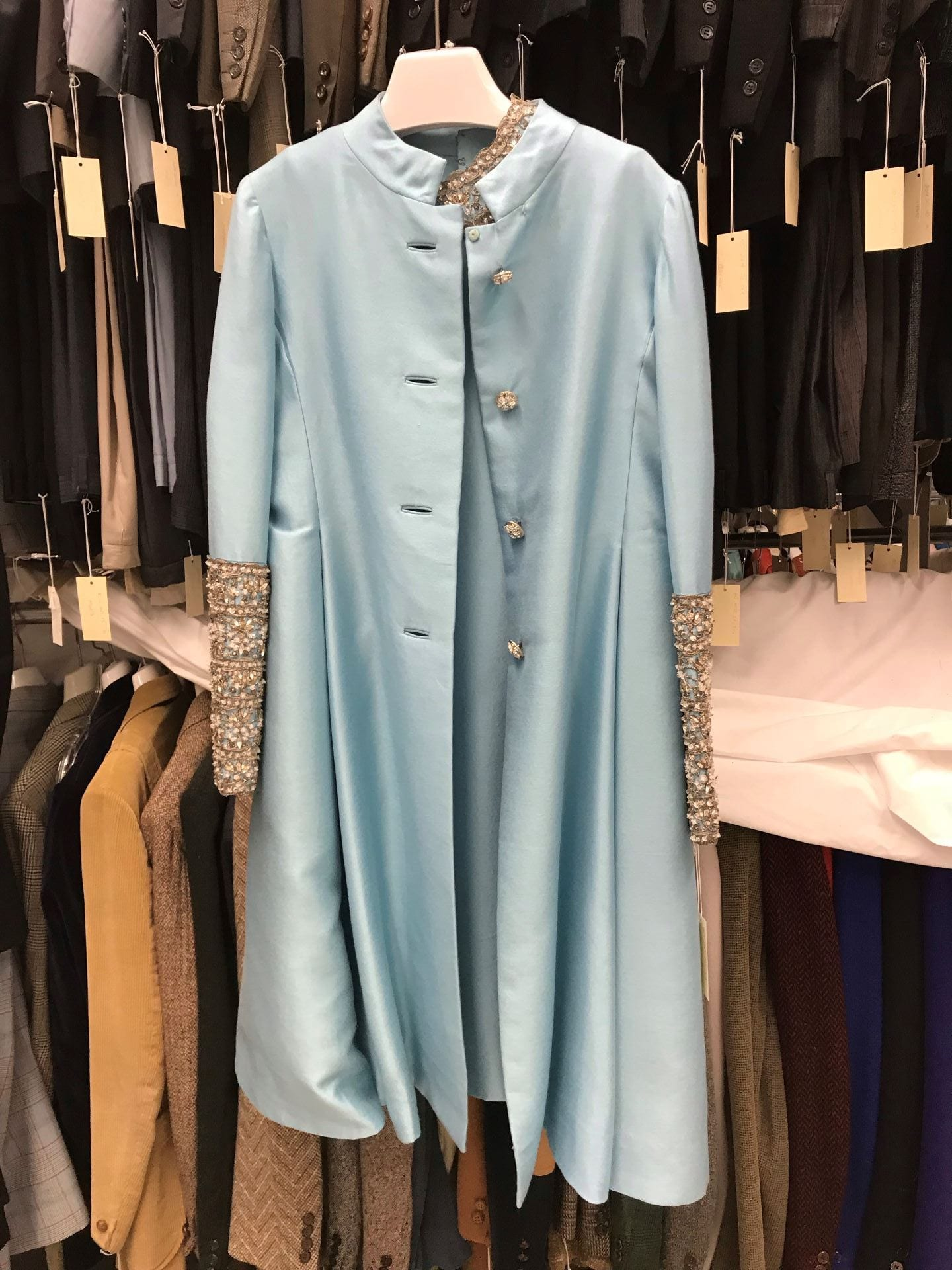 dd1ea1159c1cc0 To the right is a Malcolm Starr light blue wool short evening dress and  coat with a silver braid along with beading on the dress neckline and coat  sleeves.