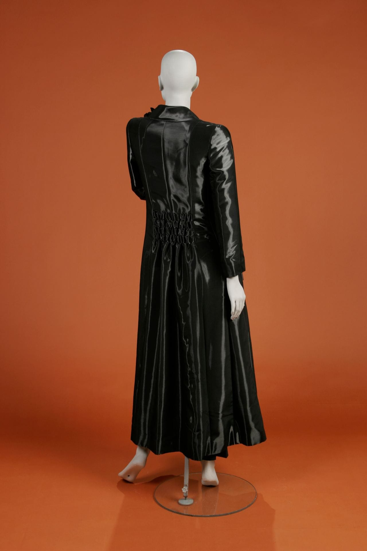 2ad931128f12 To the left is a short black wool crepe Chanel dress created by Karl  Lagerfeld. Coco Chanel was ...