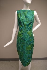 1950 through 1959 Luis Estevez short green ikat sacque dress.