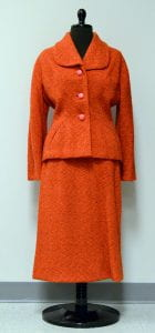 orange tweed skirt suit having jacket with nipped in waist